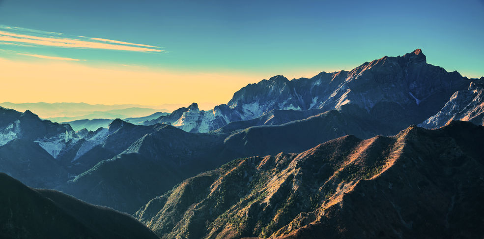 Alpi Apuane mountains and marble quarry view at sunset. Carrara, Tuscany, Italy, Europe.